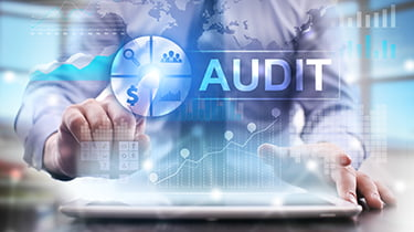 Man using audit technology to improve data quality